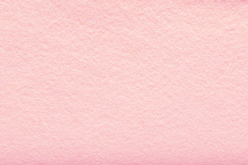 Fine grain pink woolen felt. Texture background. Velvet scarlet matte background of suede fabric