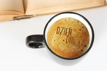 Eine Tasse Kaffee und Begrüßung auf Polnisch Dzien Dobry