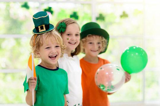 Kids celebrate St Patrick Day. Irish holiday.