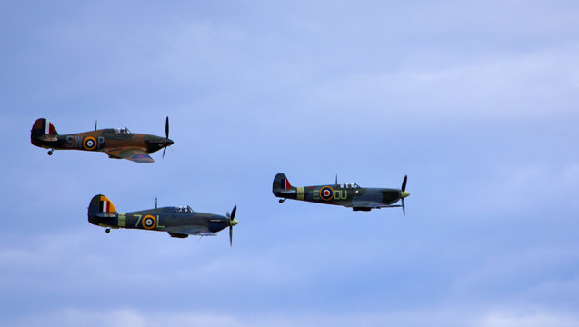A Supermarine Spitfire, Hawker Hurricane and Hawker Sea Hurricane, flying together