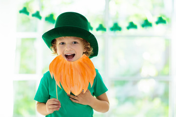 Kids celebrate St Patrick Day. Irish holiday.