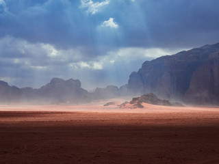 Foto op Canvas Chocoladebruin Beautiful Scenery Scenic Panoramic View Red Sand Desert and Ancient Sandstone Mountains Landscape in Wadi Rum, Jordan during a Sandstorm