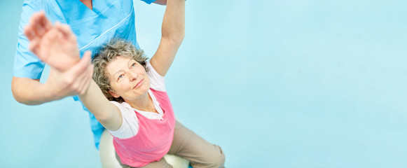 Senior makes back exercises at rehab