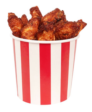 Perfect chicken wings in big red white stripes bucket box