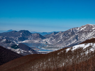 The snow-covered Matese lake seen from Monte Mutria. Matese National Park, Campania and Molise, Italy