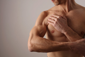 Muscular Man with scar on his shoulder after Surgery. Laser Scar Reduction concept, Sport exercising Injury