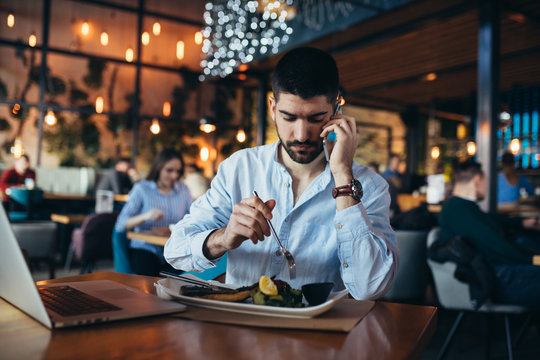 business man in restaurant working and eating