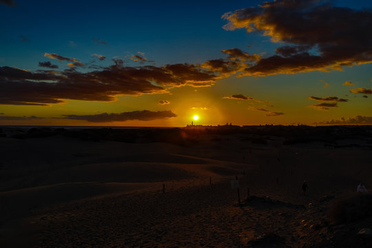 colorful sunset on the Spanish island of Gran Canaria in the Maspalomas dunes