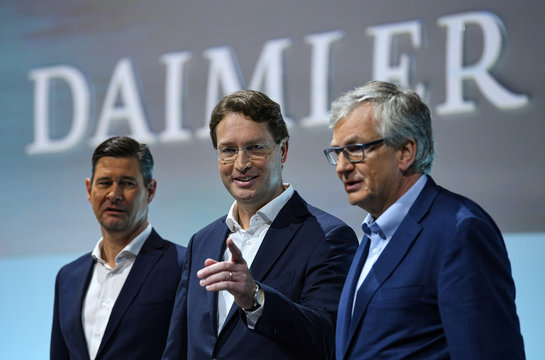 Ola Kaellenius, CEO of German luxury car manufacturer Daimler AG, gestures next to CFO Harald Wilhelm and Martin Daum, head of Daimler Trucks and Buses, during the annual results news conference in Stuttgart