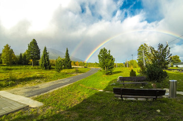 Beautiful double rainbow over woods at Vysoke Tatry town in High Tatras mountains, Slovakia. Autumn in the mountains