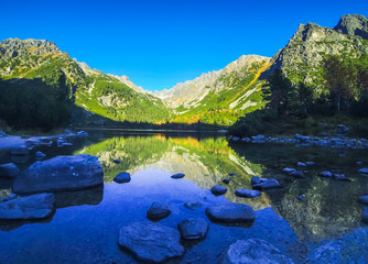 Autumn on Popradske pleso lake in High Tatras Mountains (Vysoke Tatry), Slovakia. Picturesque panoramic evening view