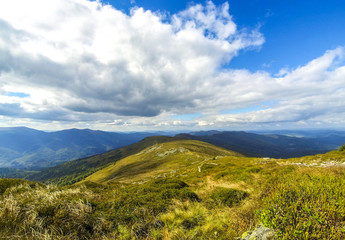 Picturesque landscape of Carpathian mountains in early autumn. View from mount Pikui (1405m). Mount Zelemenyi (1304m) on the background. Carpathians, Ukraine