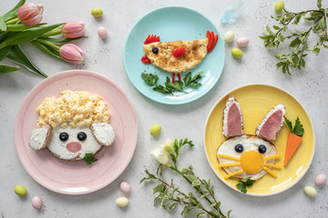 Colorful breakfast meal for kids. Funny Easter food art, top view.