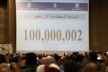 A screen showing the number Egypt's population is seen at a news conference at the Central Agency for Public Mobilization and Statistics in Cairo, Egypt