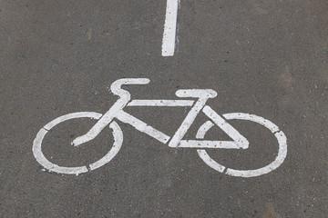 bike lane signal, painted white on asphalt road
