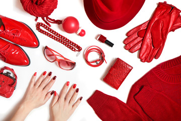 A diverse collection of clothing and accessories in red on a white background.Fashionable decorative cosmetics and nail art on women's hands from light red to dark nail Polish.