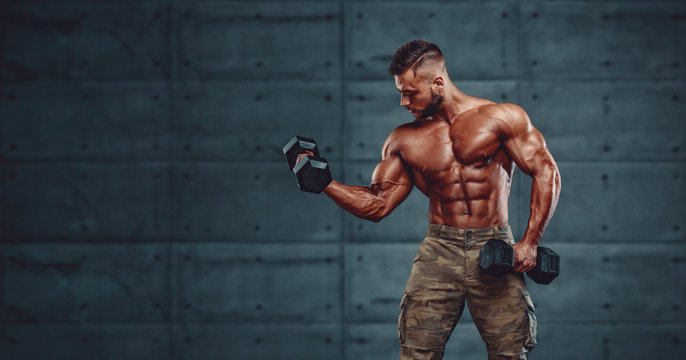 Strong Muscular Army Men Exercise With Dumbbells, Lifting Weights