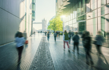 business people, modern buildings and Tower Bridge, London, UK Fotobehang