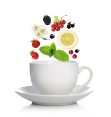 Cup of tea with herbs, fruits and berries