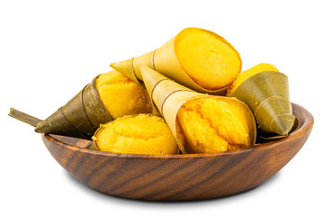 Fototapete - Pile of Toddy Palm Cake or Kanom Tarn, the local Thai dessert in wooden bowl on white background with clipping path.