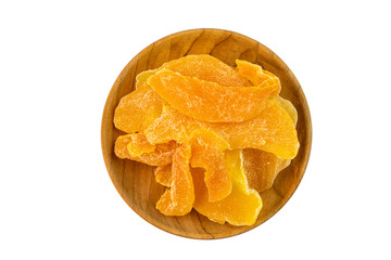 Fototapete - Top view of pile dehydrated mango in a wooden plate on white background with clipping path.