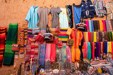 Foto op Canvas Marokko Souvenir shop with carpets, traditional clothes and other things, Ait Ben Haddou, Morocco