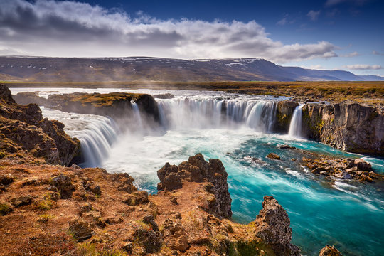 Panorama of most famous place of Golden Ring Of Iceland. Godafoss waterfall near Akureyri in the Icelandic highlands, Europe. Popular tourist attraction. Travelling concept background. Postcard.