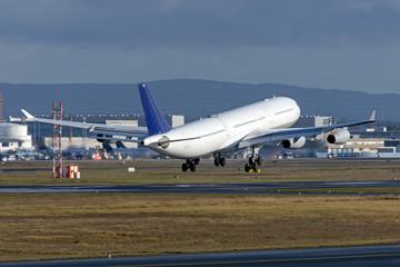 Airplane landing before gear touching the runway.