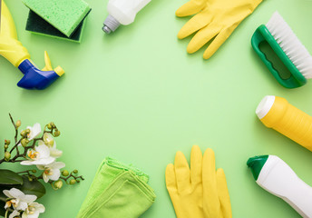 Cleaning products background, detergent bottles and tools