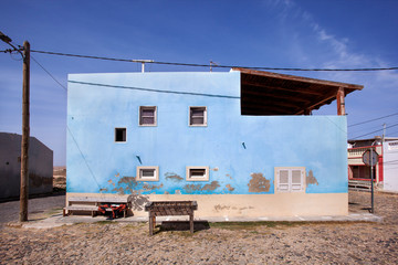 Old football table in front of a blue house in Cape Verde