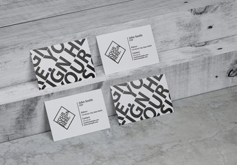 Four White Business Cards Mockup on White Wooden Stair