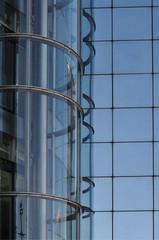 a transparent elevator at a glass facade