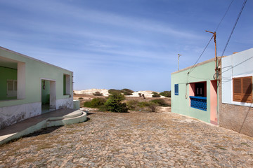 Colorful houses at the end of a paved street in Cape Verde