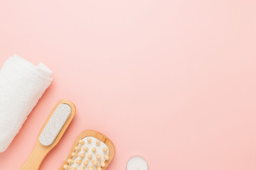 Spa and personal care objects on a pink background