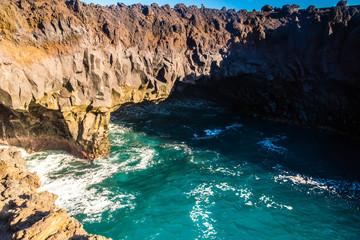 beautiful postcard landscape of Los Hervideros volcanic cliffs with atlantic waves in Lanzarote, Canary Islands, Spain - popular vacation destination