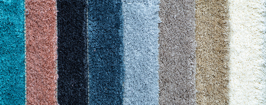 Carpet background. Striped carpets in different colors
