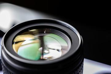 Dust on open camera lens glass