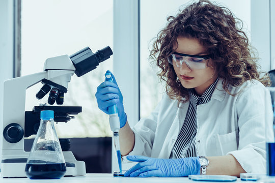 Young scientist working at the lab. Young female scientist doing some research.