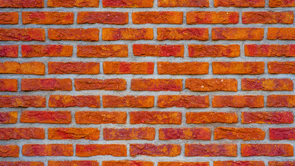 Fire red rustic brick wall texture, colorful trend color 2020