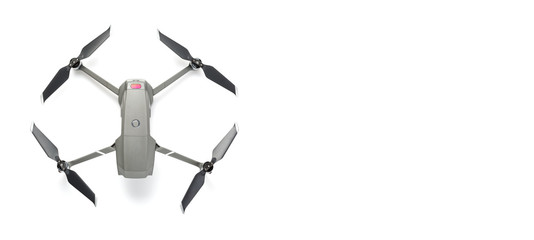 Modern drone quadcopter with a camera isolated on white background. Top view. Free space for your text