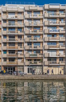 Paris, France - 04 14 2019: Building facade in Canal Lourcq.