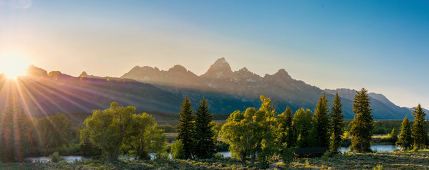 sunset over the grand tetons in grand teton national park in summer