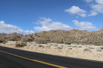 a new paved desert mountain distant road
