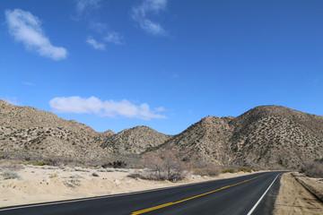 a paved desert mountain ridge road