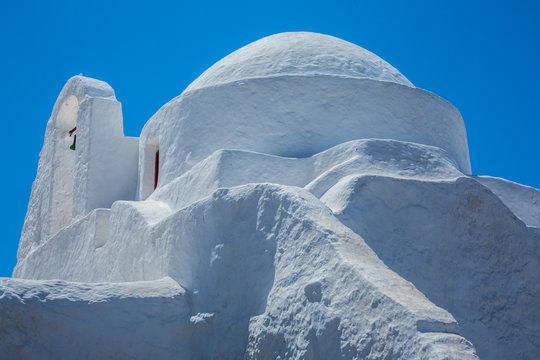 Old mediterranean architecture white Greek church under the sun in Mykonos, Cyclades, Greece
