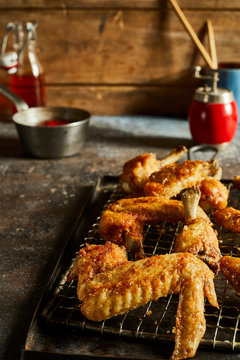Chicken wings on rustic background