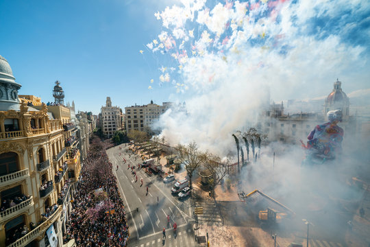 City hall square with fireworks exploding at Mascleta during the Las Fallas festival in Valencia Spain on March 19, 2019 Fallas Festival in its List of the Intangible Cultural Heritage of Humanity.