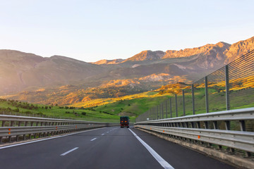 View of the highway in the mountains at sunset.