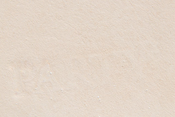 background of light beige powder closeup