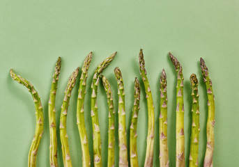 fresh asparagus on green background